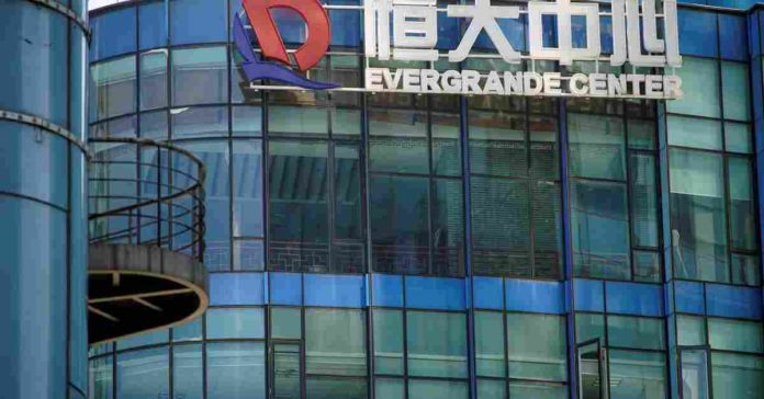 EXCLUSIVE Bank of England Woods with cautious optimism about Evergrande