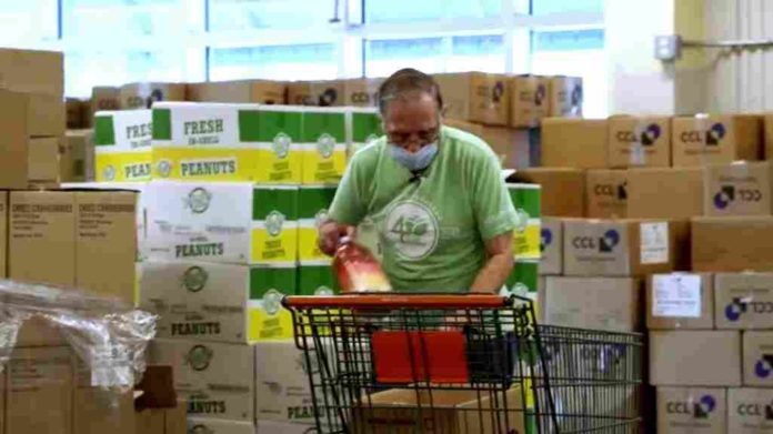 A 81-year-old man is receiving a lifetime offer as a volunteer at Mid-Ohio Food Collective